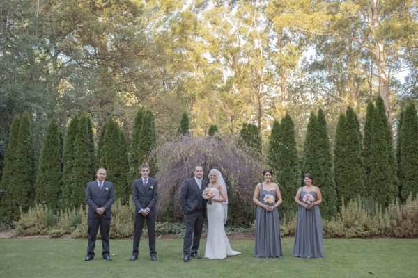 groomsmen and bridesmaids in the garden
