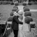 couple hug after garden wedding