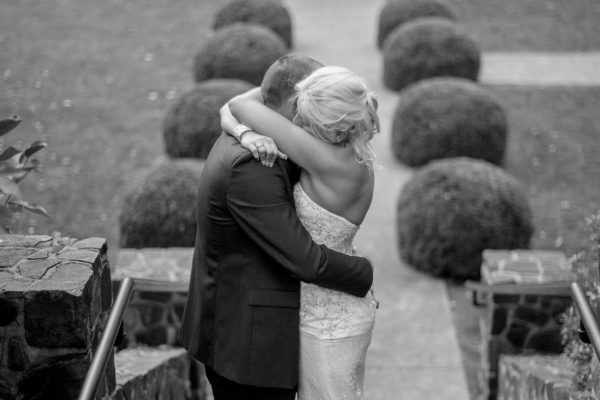 couple hug after garden wedding