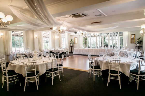 beautifully lit drapes in wedding reception room